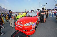 Driver Kurt Busch and friends pause for a pre-race prayer.