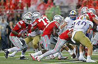 Ohio State Buckeyes quarterback J.T. Barrett (16) scores on a touchdown run against Tulsa Golden Hurricane in the 4th quarter of their game at Ohio Stadium in Columbus, Ohio on September 10, 2016.  (Kyle Robertson / The Columbus Dispatch)