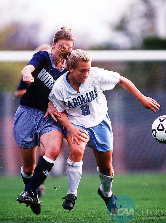 Caption: 8 December 1996: University of North Carolina forward  Debbie Keller (8) fights off Notre Dame back Kate Fisher during the Division 1 Women's Soccer Championships at Buck Shaw Stadium in Santa Clara, CA. North Carolina defeated Notre Dame in overtime, 2-1. David Gonzales/NCAA Photos