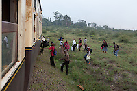 Passengers board the 6:40 AM Athi River to Nairobi commuter train.