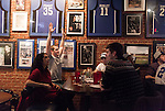 January 23, 2013. Durham, North Carolina. Nick Swartzwelder (left) a Durham native, Duke student and lifelong fan briefly celebrates a point as Duke lost a 63-90 blowout to Miami. He and his frat brothers had gathered at Charlie's Pub and Grille to watch the game.. Duke University has become a power house in the national college basketball arena under the coaching of head coach Mike Krzyzewski. But the university has fought hard to maintain its image of high academic achievement while riding the wave of collegiate athletic success.