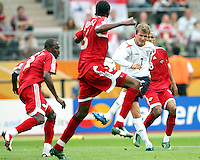 David Beckham of England tries to bend a shot through the Trinidad defense. England defeated Trinidad & Tobago 2-0 in their FIFA World Cup group B match at Franken-Stadion, Nuremberg, Germany, June 15 2006.