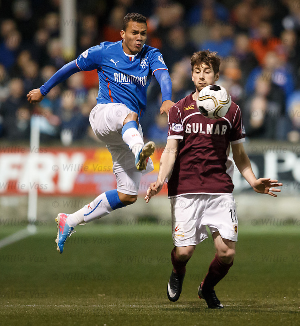 Arnold Peralta wins the ball from Darren Smith
