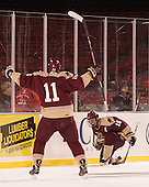 Corey Hale (Norwich - 11) and Shane Gorman (Norwich - 16) celebrate Gorman's goal. - The Norwich University Cadets defeated the Babson College Beavers 1-0 on Thursday, January 9, 2014, at Fenway Park in Boston, Massachusetts.