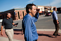 Republican presidential hopeful Tim Pawlenty, center, walks to a coffee shop after a campaign stop on Tuesday, July 26, 2011 in Washington, IA.