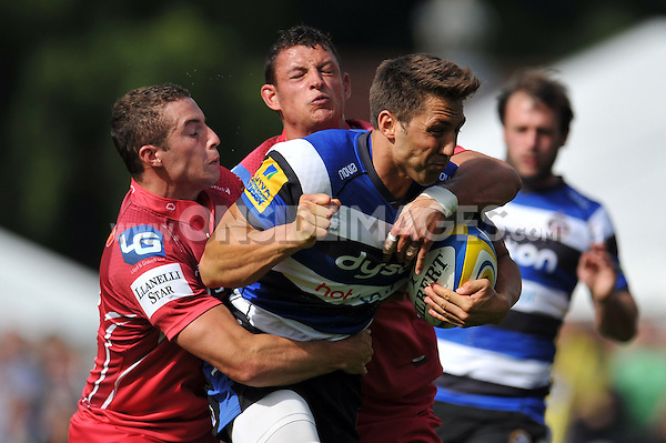 Gavin Henson takes on the Scarlets defence. Pre-season friendly match, between Bath Rugby and the Scarlets on August 16, 2014 at the Recreation Ground in Bath, England. Photo by: Patrick Khachfe / Onside Images