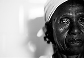 Asmara, Eritrea.November 2002.Birhan Aim Hospital (Light to the Eye Hospital)..63 year old Shiferou from Asmara, who is cataract blind in her right eye, sits outside the operating theater just moments before the cataract is removed and replaced with an artificial lens.