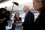 Senator John McCain, Republican presidential candidate, speaks to the press aboard his campaign plane, accompanied by his wife, Cindy (right), Dallas, Texas, January 30, 2008.