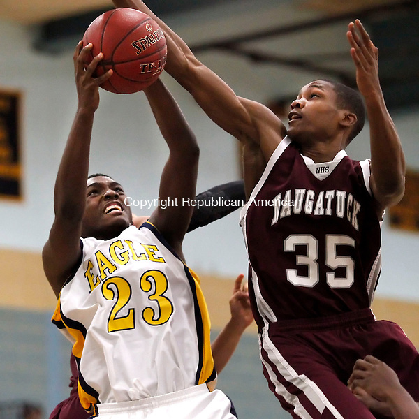 Waterbury, CT-21 December 2012-122112CM03-  Kennedy's Tyreek Middleton, left, puts up a shot as Naugatuck's Husani Foote jumps in to defend during NVL basketball action Friday night in Waterbury.  Kennedy won, 65-47.   Christopher Massa Republican-American