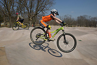NWA Democrat-Gazette/BEN GOFF @NWABENGOFF<br /> Wes Wells (left) of Bella Vista and son Teagun Wells, 9, ride Sunday, March 19, 2017, at the new pump track at the Metfield Recreation Complex in Bella Vista. The poured concrete track, the first of it's kind in the area, was recently completed by Progressive Trail Design and is located next to a mountain bike skills course and acces to the Back 40 mountain bike trails.