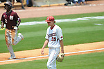 Arkansas' Ryne Stanek reacts to giving up a home run as Mississippi State's Demarcus Henderson scores in the SEC Tournament at Regions Park in Hoover, Ala. on Tuesday, May 22, 2012.