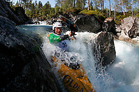 Benjamin Hjort (Norway). Kayak downhill race in the Brandseth river. The Extremesport Week, Ekstremsportveko, is the worlds largest gathering of adrenalin junkies. In the small town of Voss enthusiasts in a varitety of extreme sports come togheter every summer to compete and play. Norway.  ©Fredrik Naumann/Felix Features.