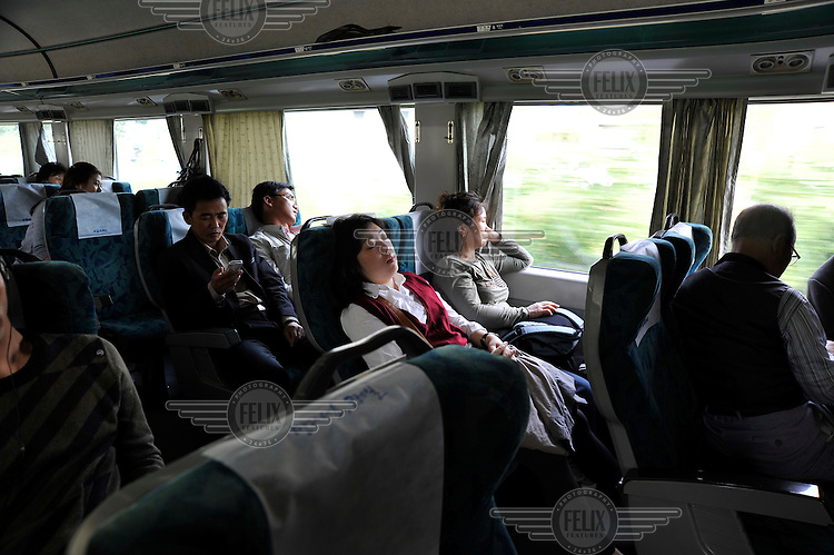 Passengers travelling aboard an intercity train, near Seoul.