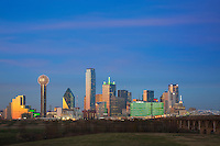 With the Omni Hotel glowing green and Reunion Tower lit in flashing lights, the Dallas skyline comes to life under a cold December sky.