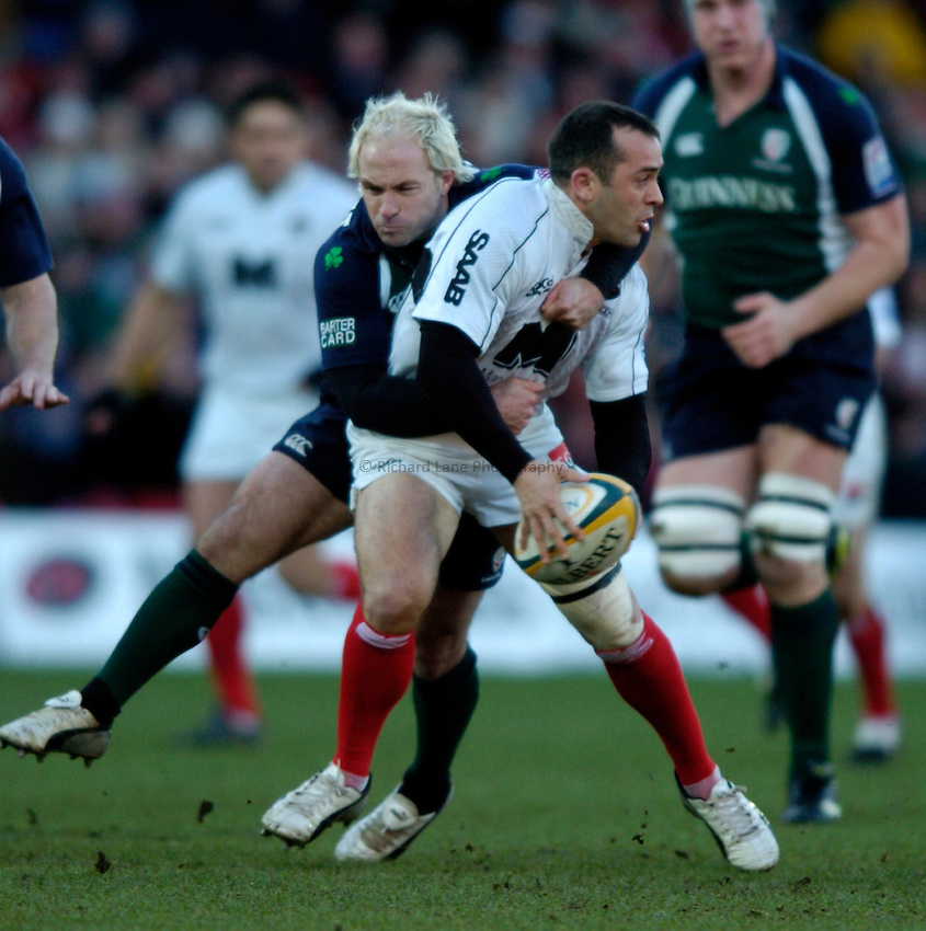 Photo: Richard Lane..Saracens v London Irish. Powergen Cup. 23/01/2005..Thomas Castaignede is tackled by Mark Mapletoft.