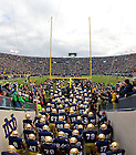 Nov. 2, 2013; The football team enters Notre Dame Stadium before the Navy game, 2013.<br /> <br /> Photo by Matt Cashore