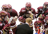 The Eagles gather around Greg Brown (BC - Assistant Coach) during Northeastern's timeout. - The Northeastern University Huskies defeated the Boston College Eagles 3-2 on Friday, February 19, 2010, at Matthews Arena in Boston, Massachusetts.