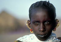 ca. 1978, Amadou Moussa, Mauritania --- Mauritanian Woman with Multiple Earrings --- Image by &copy; Owen Franken/Corbis