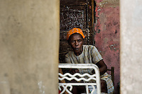 A Haitian woman in front of a house in the slum of Cité Soleil, Port-au-Prince, Haiti, 24 July 2008. Cité Soleil is considered one of the worst slums in the Americas, most of its 300.000 residents live in extreme poverty. Children and single mothers predominate in the population. Social and living conditions in the slum are a human tragedy. There is no running water, no sewers and no electricity. Public services virtually do not exist - there are no stores, no hospitals or schools, no urban infrastructure. In spite of this fact, a rent must be payed even in all shacks made from rusty metal sheets. Infectious diseases are widely spread as garbage disposal does not exist in Cité Soleil. Violence is common, armed gangs operate throughout the slum.