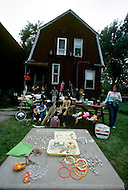 Detroit. U.S.A, September, 1980. America severely marked by the recession. The first to be affected are  workers on the bread line and elderly persons without means. An unemployed mother is selling the family's belongings in order to make some cash.