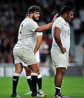 Rob Webber of England encourages his fellow forward Mako Vunipola during a break in play. QBE International match between England and France on August 15, 2015 at Twickenham Stadium in London, England. Photo by: Patrick Khachfe / Onside Images