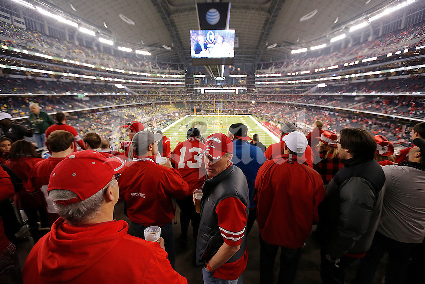 Fans mingle with their beers before the College Football Playoff National Championship at AT&T Stadium in Arlington, TX on Monday, January 12, 2015. (Columbus Dispatch photo by Jonathan Quilter)