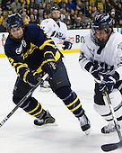 Kyle Bigos (Merrimack - 3), Phil DeSimone (UNH - 39) - The Merrimack College Warriors defeated the University of New Hampshire Wildcats 4-1 (EN) in their Hockey East Semi-Final on Friday, March 18, 2011, at TD Garden in Boston, Massachusetts.