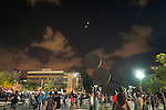 TEL AVIV, ISRAEL<br /> Israelis look up to the sky, where an 'Iron Dome' missile intercepts a rocket that was fired from Gaza, during operation Protective Edge.