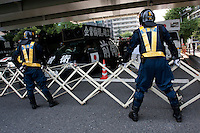 Japanese police in riot gear guard right wing Uyoku dantai nationalists protesting against a left wing march during the commemoration of the end of the Pacific war at Yasukuni Shrine, Kudanshita, Tokyo, Japan. August 15th 2010