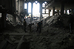 A Palestinian youth inspects the rubble of a mosque after it was hit in an Israeli missile strike in the Jebaliya refugee camp, northern Gaza Strip, Friday, Jan. 2, 2009. Israel showed no sign of slowing a blistering seven-day offensive against Gaza's Hamas rulers, destroying homes of more than a dozen of the group's operatives Friday and bombing one of its mosques a day after a deadly strike killed a prominent Hamas figure. APAIMAGES PHOTO / Ashraf Amra