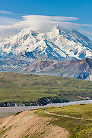 Hiker on the trail in front of Eielson Visitor's Center with Denali,  in the distance, Thorofare river, Denali National Park, interior, Alaska.