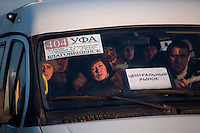 People ride a minibus bound for the Central Market in Ufa, Bashkortostan, Russia.