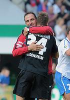 FUSSBALL   DFB POKAL   SAISON 2011/2012  1. Hauptrunde      30.07.2011 1. FC Heidenheim - Werder Bremen JUBEL Heidenheim; Trainer Frank Schmidt (re) umarmt Matchwinner Torwart Frank Lehmann (1. FC Heidenheim 1846)