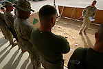 A few days before they begin the journey back to the United States after eight months in Najaf, Iraq, Marines with 1st Battalion 4th Marines and Romeo Battery receive a brief on the route they will take during the convoy that will take them to Kuwait on January 31, 2005.