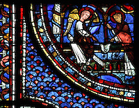 Mary Magdalene arrives at Christ's tomb to find just a shroud and an angel tells her of His resurrection, the Resurrection of Christ, from the Life of Mary Magdalene stained glass window, 13th century, in the nave of Chartres cathedral, Eure-et-Loir, France. Chartres cathedral was built 1194-1250 and is a fine example of Gothic architecture. Most of its windows date from 1205-40 although a few earlier 12th century examples are also intact. It was declared a UNESCO World Heritage Site in 1979. Picture by Manuel Cohen