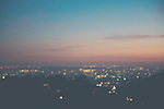 a soft focus photograph of Los Angeles lights taken from Mulholland Drive at sunset