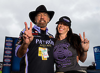 Aug 31, 2014; Clermont, IN, USA; NHRA funny car driver Alexis DeJoria (right) poses for a photo with father John Paul DeJoria during qualifying for the US Nationals at Lucas Oil Raceway. Mandatory Credit: Mark J. Rebilas-USA TODAY Sports
