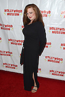 """HOLLYWOOD, CA - AUGUST 18:  Lisa Loring at """"Child Stars - Then and Now"""" Exhibit Opening at the Hollywood Museum on August 18, 2016 in Hollywood, California. Credit: David Edwards/MediaPunch"""