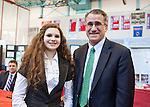 President Anthony Monaco presents the Tufts Prize to Nicole Gouveia, of Somerville, at the Region IV Science Fair at Somerville High School. (Emily Zilm for Tufts University)