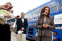 Republican presidential hopeful Michele Bachmann, joined by her husband Marcus Bachmann, talks to reporters after a campaign stop on Saturday, July 23, 2011 in Marshalltown, IA.