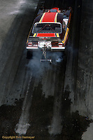 """INDIANAPOLIS, INDIANA: A Funny Car driver begins his """"burnout"""" during the 1976 NHRA US Nationals in Indianapolis, Indiana."""