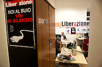 Roma 30 Dicembre 2011.Ultimo giorno del quotidiano comunista  Liberazione che  sospenderà «in via cautelativa» le pubblicazioni dal primo gennaio dopo i tagli al finanziamento pubblico ai giornali cooperativi. I  giornalisti e poligrafici hanno occupato la redazione dopo la rottura  del tavolo sindacale del 27 dicembre con l'editore..Rome, December 30, 2011.Last Day of the communist newspaper Liberazione that will suspend the  publications from January 1 after the cuts to public funding for cooperative newspapers. Journalists and polygraphic have occupied the newspaper office  against the closure....