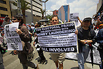 Mexican demonstrators march as they stage a rally against Enrique Pena Nieto on main Mexico City's  thoroughfares, July 22, 2012.Protests all over Mexico marked the demonstrations to prevent Enrique Pena Nieto to take office on December 1, 2012. Photo by Heriberto Rodriguez