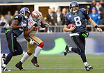 Seattle Seahawks quarterback Matt Hasselbeck scrambles against the  San Francisco 49ers  at QWEST Field in Seattle.  Jim Bryant Photo. ©2010. All Rights Reserved