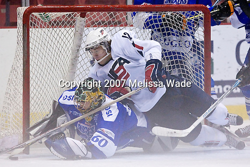 Aaron Palushaj (UMichigan - Northville, MI) lands on Juha Metsola (Finland/Lethbridge Hurricanes - Finland). Team White for the USA defeated Team Finland 5-4  on Wednesday, August 8, 2007, in the 1980 Rink at Lake Placid, New York during the Summer Hockey Challenge.