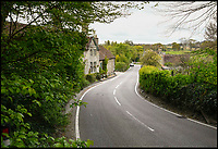 BNPS.co.uk (01202 558833)<br /> Pic: GrahamHunt/BNPS<br /> <br /> C13 through Melbury Abbas.<br /> <br /> A sleepy Dorset village is getting jammed up to 18 times a week with big lorries after highways officials deliberately directed them to drive through it in a controversial traffic experiment.<br /> <br /> The 'unbelievable' strategy has brought havoc and misery to Melbury Abbas where villagers are getting used to the sight of a 30 tonne HGV blocking the narrow main road.<br /> <br /> Cars heading through the pretty hamlet face delays of up to an hour whenever a hapless trucker attempts to pass another large vehicle using the C13.<br /> <br /> Kerbs, grass verges and a water hydrant have been badly damaged by truckers mounting them to create space to squeeze though, while one HGV came within just 2ins of colliding with a Grade II listed property on one occasion.