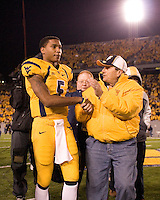 WVU quarterback Pat White appears to still be feeling the effects of a concussion as he walks off the field after the West Virginia Mountaineers defeated the Louisville Cardinals 38-31 on November 08, 2007 at Mountaineer Field, Morgantown, West Virginia. .
