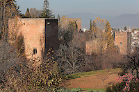 The Tower of the Princesses or Torre de las Infantas on the left, a small palace, and other towers along the Cuesta de los Chinos, an ancient entrance to the Alhambra, with paths linking El Albayzin, the medieval Moorish old town of Granada, with the Alhambra and the Generalife, Alhambra, Granada, Andalusia, Southern Spain. The Alhambra was begun in the 11th century as a castle, and in the 13th and 14th centuries served as the royal palace of the Nasrid sultans. The huge complex contains the Alcazaba, Nasrid palaces, gardens and Generalife. Granada was listed as a UNESCO World Heritage Site in 1984. Picture by Manuel Cohen