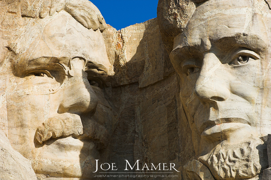 Close up view of Abraham Lincoln and Theodore Roosevelt at Mount Rushmore National Memorial.