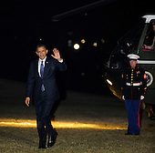 United States President Barack Obama arrives on the South Lawn of the White House in Washington, D.C. after a three day West coast trip, early Saturday morning, February 18, 2012, in Washington, DC.  .Credit: Leslie E. Kossoff / Pool via CNP